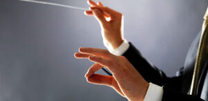 conductor hands baton