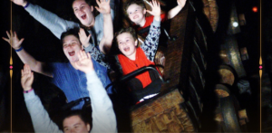 kids on a roller coaster at Disney World Magic Kingdom Splash Mountain