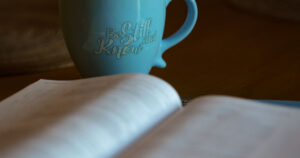 coffee mug with bible Be Still and Know
