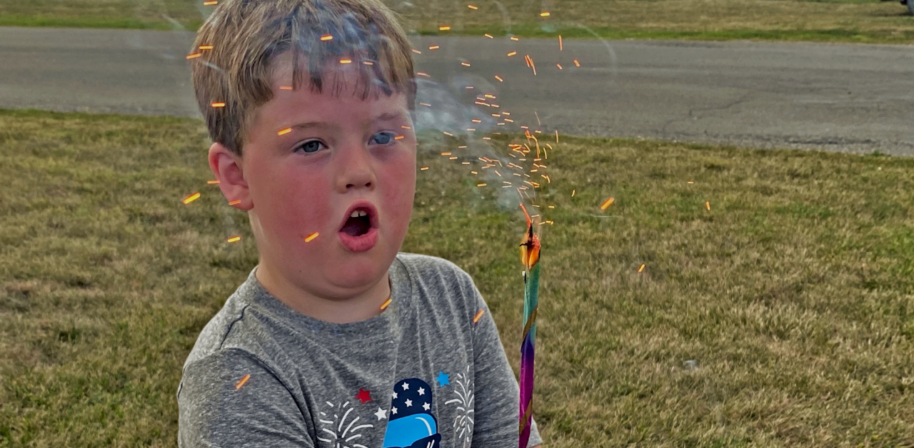 young boy with a sparkler
