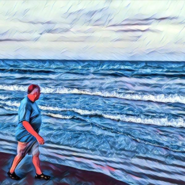 Jeremy Henson walking on beach man